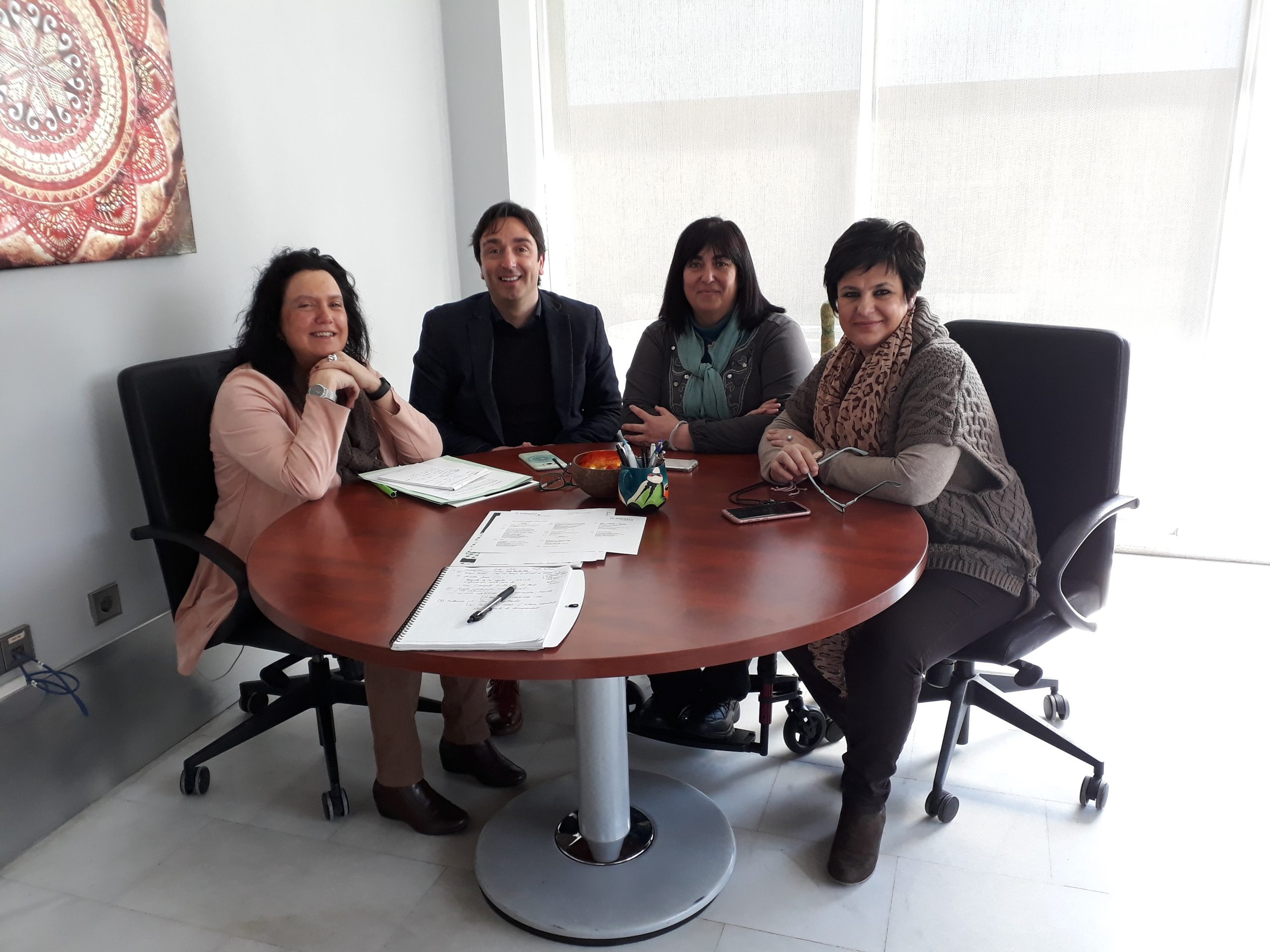 Foto reunión colaboración con ASPAYM